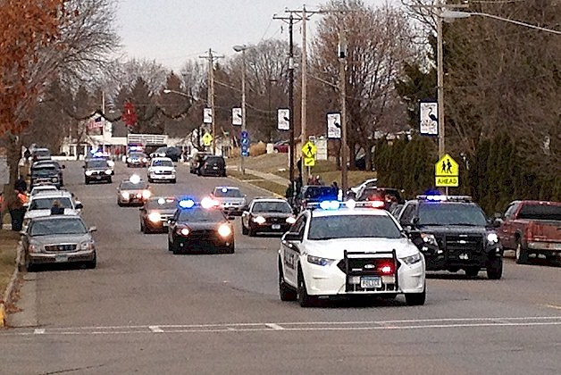 The funeral procession for Officer Tom Decker moves through Cold Spring on its way to the St. Nicholas Cemetery