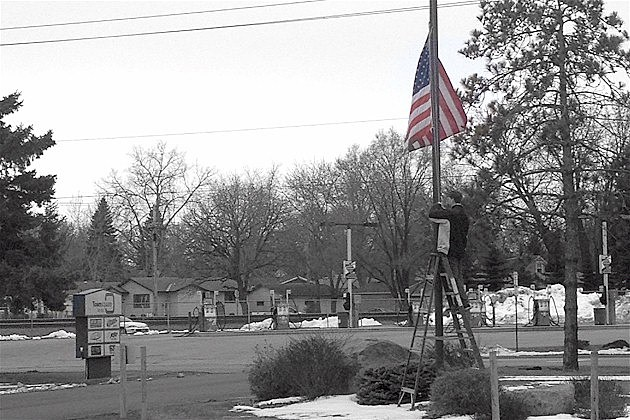 Flag lowered at townsquare media st cloud building paying respects to