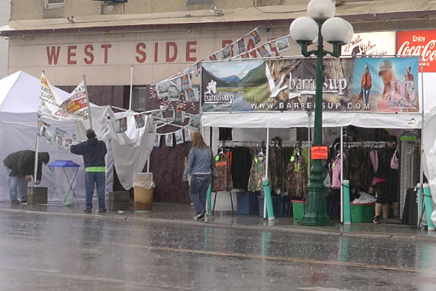 Rain pours down on the Little Falls Art Fair this morning
