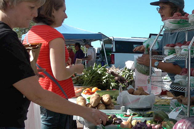Members of the community purchase fresh produce