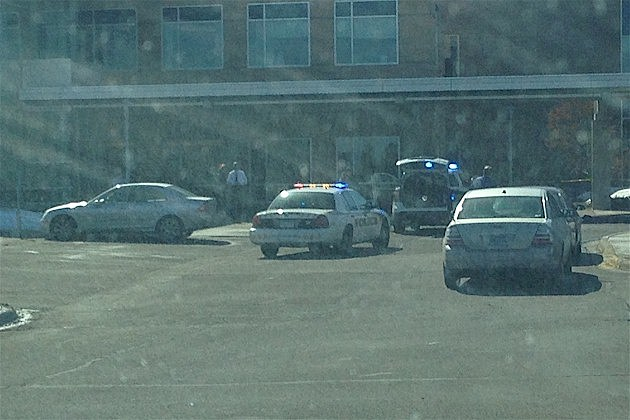 Police respond to a shooting victim dropped off at the CentraCare Health Plaza on March 13, 2014.