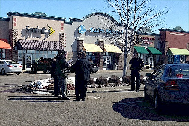 Police investigate shooting outside Sartell Sprint Store, March 13, 2014.