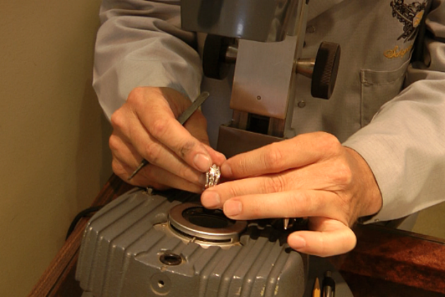 A ring is inspected under the microscope at Schepers Jewelers (Photo: Alex Svejkovsky, WJON)
