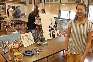 Ramona Kuhn standing in front of some of her artwork. (Dan DeBaun, WJON)