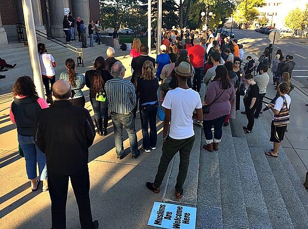 Community listening to Speakers at Stand United Rally. Rebecca David, WJON