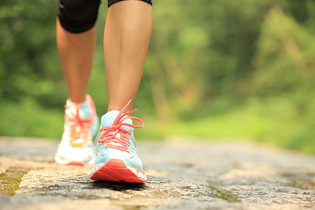 fitness woman hiker feet hiking on stone trail